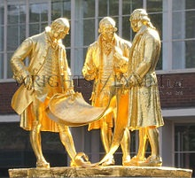 The gilded bronze statue of Matthew Boulton, James Watt and William Murdoch by William Bloye and Raymond Forbes-Kings